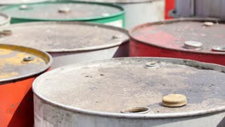 Dirty barrels with used engine oil