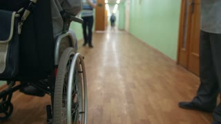 Disabled man on a wheelchair standing inside hospital or university