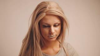 Fashion backstage - blonde model posing for photographer in studio - joy feeling