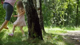 Father is running with his Daughter in summer park, slow-motion