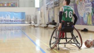 February, 2018 - Kazan, Russia - Training of disabled sportsmen - men is playing wheelchair basketball