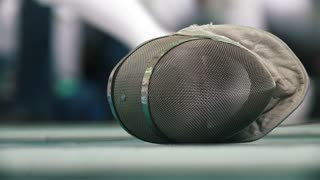 Fencing protective mask on the floor during sport tournament