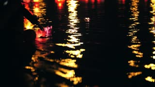 Floating lighting Lanterns on night river - romantic concept