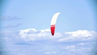 Flying sail for kite boarding in the cloudy sky
