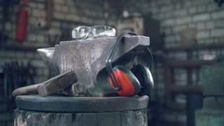 Forge workshop - hammer, anvil and protect headphones