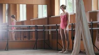 Girl Ballet Dancer Training in mirror room