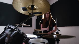 Girl is very emotional drummer plays the drums in the studio