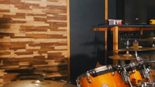 Girl sits down the drums and starts playing