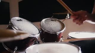 Girl with red hair playing drums