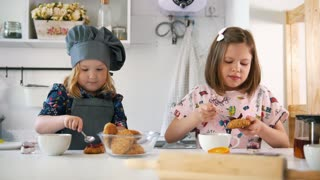 Group of children decorating cookies with jam