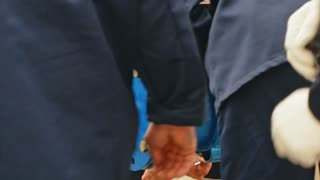 Hands of male in uniform working with water pipes on water supply system