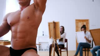 Handsome shirtless muscular guy is posing for girls artists