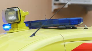 Head flashing light strobe on emergency ambulance car