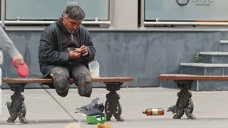 Homeless disabled beggar on city street