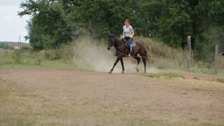 Horseback riding lessons - young woman riding a horse, slow-motion