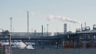Infrastructure of industrial power plant, smoking pipes, pipelines and torch