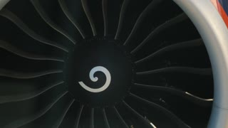 Jet engine rotor blades rotating - airplane in airplane