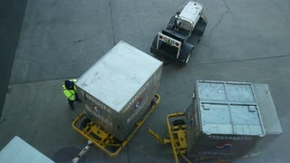 JFK Airport, NEW YORK, USA - DECEMBER, 2017 - the cargo for loading on the plane is transported on the runway