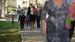 Kazan, Russia, 1 september 2017: Boys and girls and they parents - children with flowers at first day of school. Beginning of school year