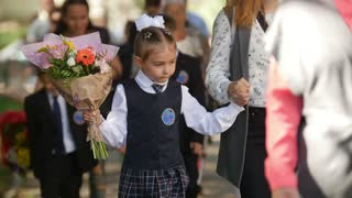Kazan, Russia, 1 september 2017: Young children with flowers at first day of school. Beginning of school year
