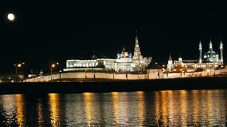 Kazan, Russia, 12 may 2017 - Kazan kremlin with reflection in river at night - full moon