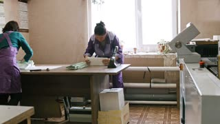 Kazan, Russia - 29 september 2016 - immigrant's work - Illegal woman workers at printing house - polygraph industry