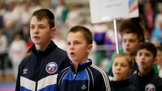 "Kazan, Russia, 8 april 2017, Palace of single combats ""Ak Bars"" Kids karate competition WKF - boys sportsmen sing the national anthem of Russian Federation"