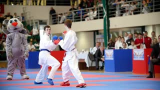 "Kazan, Russia, 8 april 2017, Palace of single combats ""Ak Bars"" Kids karate competition WKF - boys teenager's fighting, slow-motion"