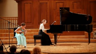 Kazan, Russia - april 15, 2017: Saydashev State Great Concert Hall - two teenagers girl plays pianoforte and mandolin