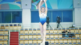 KAZAN, RUSSIA - APRIL 18, 2018: All-Russian gymnastics championship - female athlete gymnast performing a leap at the balance beam