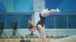 KAZAN, RUSSIA - APRIL 18, 2018: All-Russian gymnastics championship - flexible young female gymnast performing at the stadium