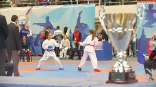 KAZAN, RUSSIA - APRIL 7, 2018:, teenager girls fighting in kimono at all-Russian karate championship
