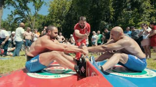 KAZAN, RUSSIA - JUNE 23, 2018: Traditional Tatar festival Sabantuy - Strong men wrestling outdoors at summer day
