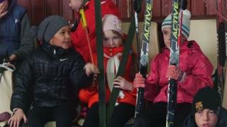 KAZAN, RUSSIA - MARCH, 2018: Children girls sitting on tribunes at the ski marathon
