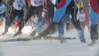KAZAN, RUSSIA - March, 2018: Men skiers running ski marathon, big group at the start of the race