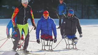 KAZAN, RUSSIA - March, 2018: slow motion of skiers with disabilities participating in the winter ski-race, skier passing by them