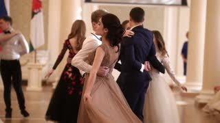 KAZAN, RUSSIA - MARCH 30, 2018: Couples whirling in the beautiful dance at party in city hall
