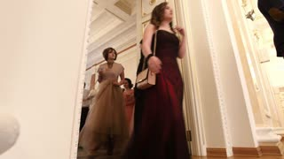 KAZAN, RUSSIA - MARCH 30, 2018: Dance party in city hall - young couples in the lush dresses coming on the reenactment ball