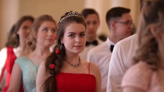 KAZAN, RUSSIA - MARCH 30, 2018: Dance party in city hall - young couples in the lush dresses on the reenactment ball
