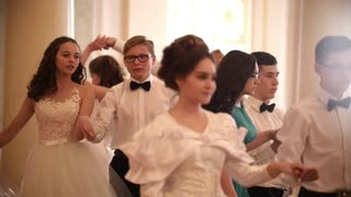 KAZAN, RUSSIA - MARCH 30, 2018: Student couples in attractive vintage dresses dancing waltz