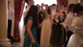 KAZAN, RUSSIA - MARCH 30, 2018: Student couples in attractive vintage dresses going at the ballroom