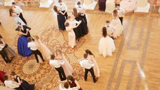 KAZAN, RUSSIA - MARCH 30, 2018: Student couples in vintage dresses dancing the waltz