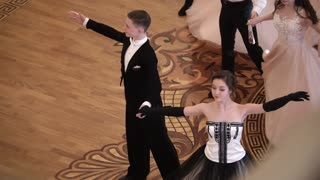 KAZAN, RUSSIA - MARCH 30, 2018: Young attractive couples in vintage clothes whirling at the ball