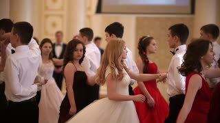 KAZAN, RUSSIA - MARCH 30, 2018: Young couples whirling in the beautiful dance at party in city hall
