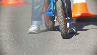 Legs of child on a Bicycle