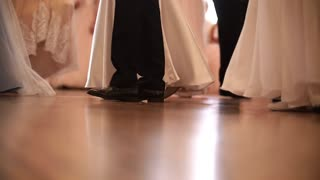 Legs of dancing young people at the historical ball, slow-motion