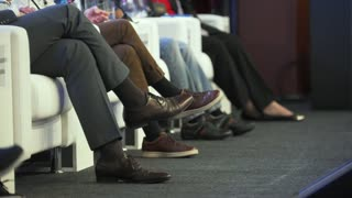 Legs of people who speakers at the business conference
