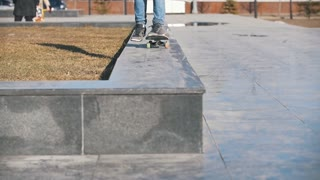 Legs of skateboarder jumping down the ramp