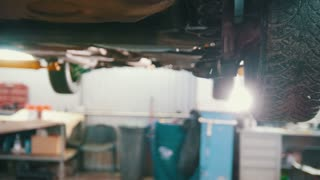 Lifted car elevated in professional service - process repairing