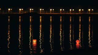 Lighting water Lanterns on river at night